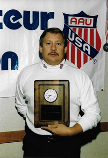 Receiving award from AAU - Mid 1990s